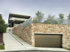 """Residential Architecture: Gordons Bay House by Luigi Rosselli Architects: """"..set on the hillside overlooking the bay,the design consists of three levels, each floor alternatively offset from the boundary by six degrees. the alternating orientation of each tier provides aresponse to different constraints imposed by the site.the garage floor is skewed to provide easy access from the adjacent lane, while maximizing the landscaped area at the front of the dwelling.the ground level alternately an"""