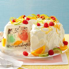 """Sherbet Cream Cake Recipe -For a show-stopping spring or summer dessert, serve this colorful, refreshing """"cake."""" This recipe takes a little time to prepare, but it's a beautiful and delicious creation. Family members often request it for their birthdays. —Paula Wipf, Arlington, Virginia"""