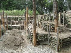 Earth Sheltered Solar Greenhouse .. I like the use of logs as a retaining wall for the beds