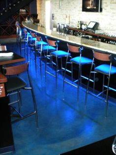 Interior commercial restaurant bar concrete stain. Caribbean Blue SoyCrete concrete stain by NW Concrete.