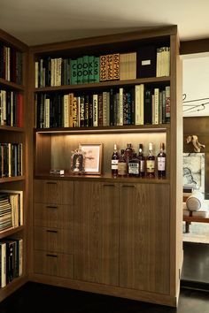 Image may contain Furniture Shelf and Bookcase Hollywood Homes, West Hollywood, Entry Stairs, 1950s House, Pierre Jeanneret, Los Angeles Homes, Fireplace Wall, Step Inside, Home Photo