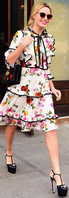 Who made Margot Robbie's white floral dress, black handbag, and platform pumps? Gucci