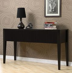 Ridgeline console table will add a touch of sophistication to your home decorSturdy furniture is made of solid rubberwoodLuxurious accent table includes two drawers