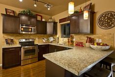 Transitional Kitchen with Wpt design whitney cylinder 1 light pendant, Pendant light, slate tile floors, Limestone Tile