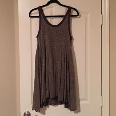 Tunic tank dress! Gold Free People tunic tank dress that's true to size! There is a slip underneath! Free People Tops Tunics