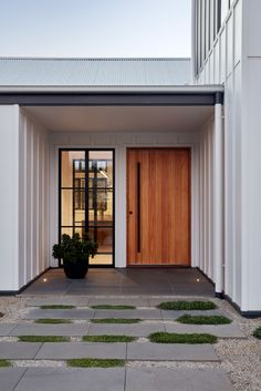 Village House Entry-GLOW design group Pivot timber entry door and board and batten cladding at the Village House by GLOW design group Modern Entrance Door, Modern Exterior Doors, Modern Front Door, Entrance Design, Front Door Design, House Entrance, Front Door Entrance, Entry Doors, Modern Garage Doors