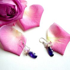 Bouquet of flowers are always a good idea, especially when it comes as dazzling purple cubic zirconia, fresh water pearl and Swarovski Crystals earrings; Purple, Cubic Zirconia, Dangle Earrings, Dainty, Lilac, Swarovski Crystals, Fresh Water Pearl, Sterling Silver Earrings, Romantic Jewelry.