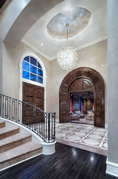 [divide]    This exquisite Texas mansion was designed by Jauregui Architects. It features a 2-story foyer with curved floating staircase, glass-enclosed wine room below the staircase, formal living & dining rooms, 2-story paneled home office/library, gourmet kitchen