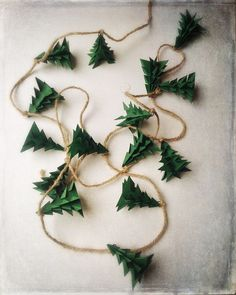 Evergreen Christmas Tree Origami Garland by EnduringVision on Etsy christmas garland Christmas Garland Rustic Evergreen Christmas Tree Decoration Decoration Christmas, Noel Christmas, Rustic Christmas, Winter Christmas, Christmas Ornaments, Holiday Decorations, Etsy Christmas, Homemade Christmas Decorations, Green Christmas