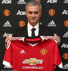 Jose Mourinho posed with a United shirt as he was announced as Van Gaal's successor on Friday morning