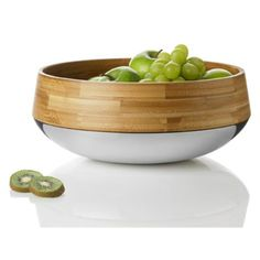 Kontra Fruit/Salad bowl has an unusual combination of the elements of bamboo and shiny steel. Bamboo brings warmth and depth to the curves of this gorgeous bowl which contrasts against the cool smoothness of the steel. A tactile and elegant bowl to bring Modern Fruit Bowl, Modern Bowls, Fruit Holder, Serveware, Tableware, Kitchenware, Beautiful Fruits, Bowl Designs, Scandinavian Kitchen