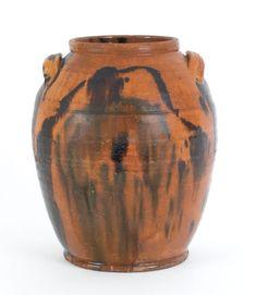 Bristol County, Massachusetts redware jar, ca. 1830, with manganese splash decoration, 13'' h.