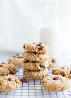 Cranberry Coconut Oatmeal Cookies- thick and chewy oatmeal cookies stuffed with dried cranberries, shredded coconut and a touch of lemon zest. Made without butter or refined sugar!