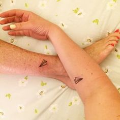 Two paper airplanes flying, flying. | 26 Taylor Swift Tattoos That Will Give You All The Feels