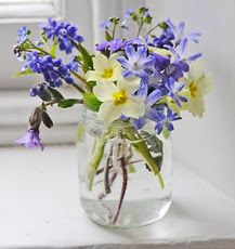 Simple jar, spring flowers in blue and yellow.