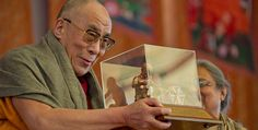 The Dalai Lama receiving the International Award for Reconciliation and Peace during the Kalachakra for World Peace in Bodh Gaya, India, on January 4, 2012.