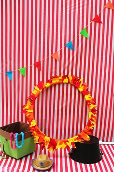 Ryder's 2nd Birthday Party: Circus/Carnival Theme! The photo booth and props .....Ring of Fire was made from an old hula hoop and cut up pieces of felt....my favorite of the party!!