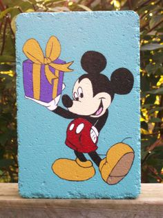 I painted this paver for my neighbor's 60th birthday because she's a Disney nut.