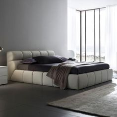 Cloud Bed      Made in Italy by Rossetto     Designed for use with a mattress only     Hardwood frame     Overstuffed, detailed stitched squares add depth and softness     Available in queen or king sizes     Offered in beige or brown leatherette     Some assembly required  #ContemporaryFurniture #bedroom #bed