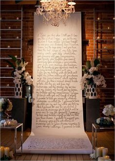 We love this alternative wedding backdrop! Make a statement with your vows or a favorite book passage with just a roll of butcher paper and some paint. More unconventional wedding ideas from Wedding Party. Photo by This Modern Romance