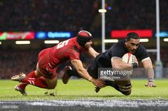 News Photo : Jerome Kaino of the All Blacks scores his sides...