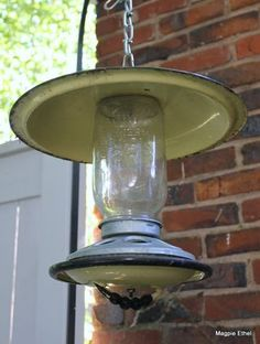 Bird feeder made from enamelware lids and chicken feeder