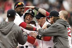 Boston Red Soxs Jacoby Ellsbury, third from left, is mobbed by David Ortiz, second from left, and other teammates after his walkoff two-run double during the ninth inning of a 6-5 win over the Cleveland Indians in a baseball game at Fenway Park in Boston, Sunday, May 26, 2013. (AP Photo/Winslow Townson)