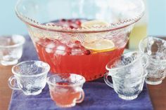 A Champagne Punch is perfect for any party and they are so easy to make! Your guests will love drinking one of these fruity party punches.