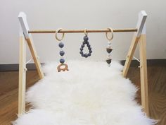 Our handmade modern timber play gyms are perfect to stimulate your babys senses and are designed to help your baby learn skills such as reaching and grasping as well as increase their muscle development, hand-eye coordination and gross motor skills. ***PLEASE NOTE BELOW BEFORE PURCHASING*** * This listing is for our standard white dipped tip frame, if you are wanting us to dip tips of frame in another colour please include in message at the time of purchase. * To select your colour…