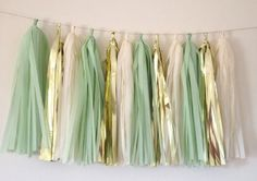 This listing is 12 Tassels on a shimmery 12 foot garland cord. 4) Mint Green 4) Metallic Gold and 4) Vanilla WhiteOur tassels are 15 inches long, longer and fluffier than any other tassels available for purchase.We use high quality paper and keep our fringe at a luscious - fifteen inches - long. Your garland will come pre strung, but not tied, allowing you to customize their position, whether it be on either side of a dessert table, or maybe delicately floating above your guests heads....