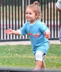 cute Harper just kick a goal! like father like daughter