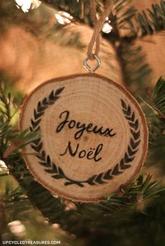 A rustic Christmas ornament - tree slice with a hand-drawn design in Sharpie