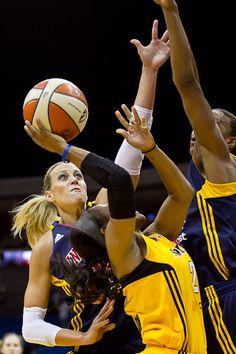 Katie Douglas goes for the block