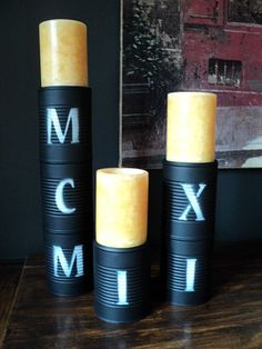 Candle Pedestals made from upcycled soup cans decorated with trendy Roman numerals.