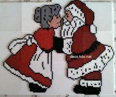 Cute kissing Mr and Mrs Claus