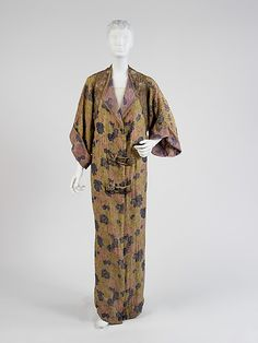 Silk evening coat, ca. 1912, Paul Poiret, French. This coat shows a unique blend of cultural references: Japanese kimono shape, in a textile resembling Victorian wallpaper. His early designs, such as this, use exaggerated narrow lines to emphasize the corset-free silhouette which Poiret advocated throughout his career.