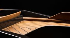 monocoque paddle canoe is crafted of copper-woven carbon fiber + classic teak wood