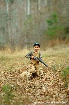 Young hunter with yellow Lab pup.  Such a cute picture.