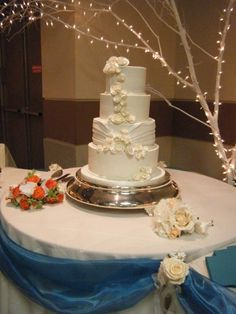 Rolled Rose Wedding Cake, love the white on white.......very classy