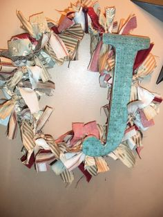 Made from scraps of fabric, a wire hanger and a wooden letter made from left over plywood, scrapbook paper and Mod Podge. Super Easy! Check out my blog for step-by-step instructions http://jonescreekcreations.blogspot.com/#
