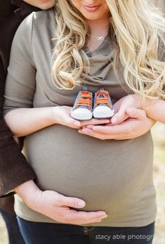 OHH really love this one with the shoes and the placement of the dad's hand on the baby bump. SO sweet!