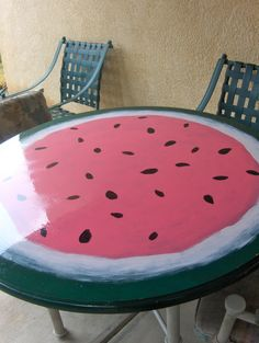 """our """"upcycled"""" patio table - old green kitchen table painted to look like a watermelon. Makes eating outside so much fun!"""