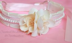 Ivory Silk Sakura Collar is made with a double satin ivory ribbon base, white lace, baby pink satin, and is fully bondage proof :) The flowers are