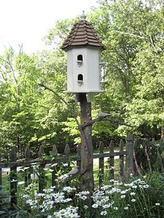 rustic birdhouse post w/ branches.  Need to put a really pretty and rather large birdhouse on the tall tree stump out back.