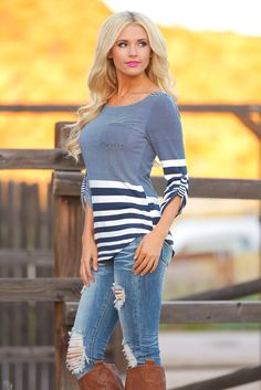 Best Seller! Stripe Top with Pocket. 3/4 sleeve with roll tab and rounded hem. Pair this with your favorite jeans and boots! 97% Poly, 3% Spandex. Tasha is 5'5