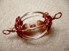 Double Swivel Bead ~~ The directions are a little confusing, but all-in-all it looks doable. :}