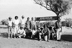 Gurindji strikers at Wattie Creek, next to the sign that they had made to assert their claim over their lands. The sign reads: 'GURINDJI, MINING LEASE AND CATTLE STATION'
