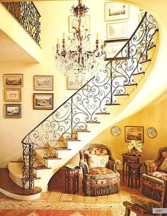 I love this filigree curving staircase and the little nook beneath!