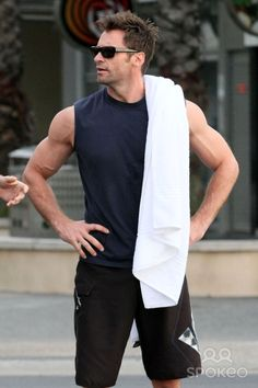 """A toned Hugh Jackman goes for a swim in the ocean at Sydney's famous Bondi Beach after an early morning training session. Jackman is currently promoting his newest film """"Real Steel,"""" about a new sport in the future where robots fight in the boxing rink."""
