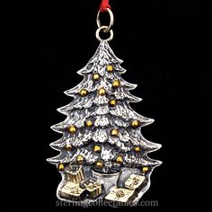 "1989 Buccellati Tree Sterling Ornament, Original Box.The ornament measures 3.5"" high. $850"